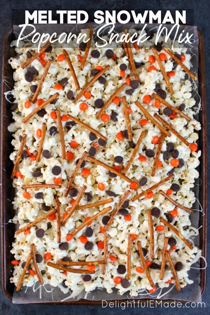 Melted snowman popcorn snack mix on cookie sheet