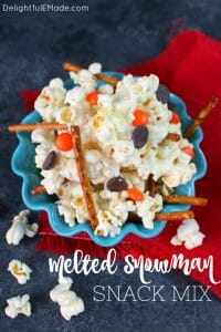 Want a fun popcorn snack mix to go with your hot cocoa? This Melted Snowman Popcorn Snack Mix is fantastic for a snow day! Made with just 5 simple ingredients, this snack mix recipe is great for watching Christmas movies or snacking after building a snowman.