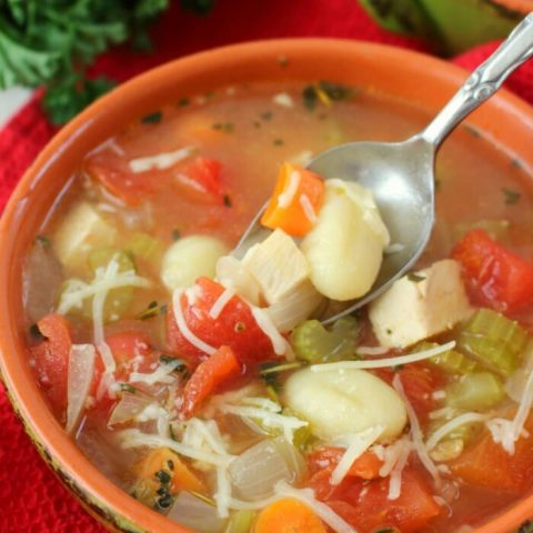 Meet your new favorite chicken and dumplings recipe! This Italian Chicken and Dumpling Soup is loaded with vegetables, gnocchi and Italian herbs. A simple soup recipe that will become your new favorite comfort food!