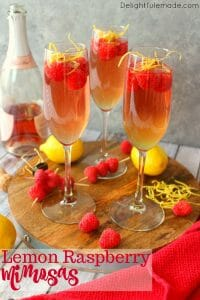 Mimosas brought to a whole new, glorious level! These Lemon Raspberry Mimosas are made with fresh raspberries, lemoncello liqueur, and topped off with a Champagne Rosé. Your brunch just got even more fabulous!