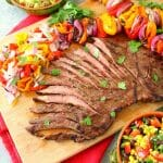 Get restaurant quality fajitas right at home! These savory Grilled Steak Fajitas will be your new favorite Tex-Mex meal. Made with tender, juicy flank steak and grilled with peppers and onions, this fajita recipe is simple to make and completely delicious!