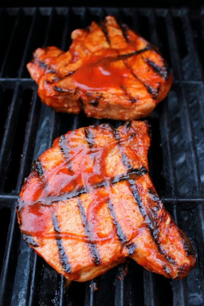 Meet your new favorite BBQ Pork Chops recipe! These super-simple grilled pork chops are made with a homemade honey bourbon barbecue sauce, and grilled to perfection. This will be your new favorite way to grill pork chops!