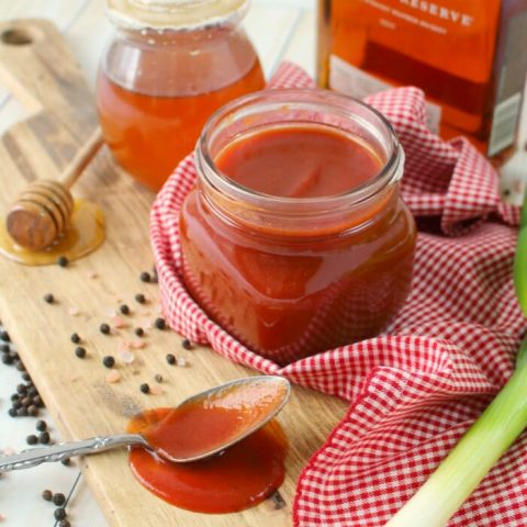 Forget the bottled stuff, you'll want to grill everything in this delicious Honey Bourbon BBQ Sauce! Sweet, savory and with a bit of spicy kick, this homemade barbecue sauce recipe is super simple to make and fantastic on pork chops, chicken, ribs and even burgers!