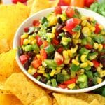 Perfect with your favorite tortilla chips, this delicious Southwestern Corn Salsa is amazing! Loaded with fresh, delicious veggies, this easy salsa recipe is just as flavorful as it is pretty. Fantastic as an easy appetizer for game day, and perfect for Cinco de Mayo!
