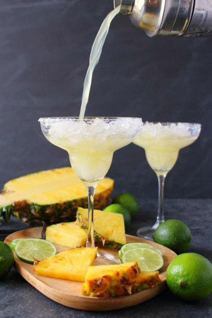 An amazing way to enjoy a fresh, delicious margarita! This easy Pineapple Margarita recipe is just 5 ingredients and comes together in moments. Fabulous for your next happy hour or celebrating Cinco de Mayo!