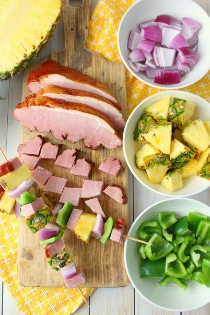 Get your cookout game on point with these incredible Hawaiian Ham & Pineapple Kebabs! Made with savory, delicious ham, fresh pineapple and veggies, these simple ham skewers will be your new favorite summer grilling recipe!