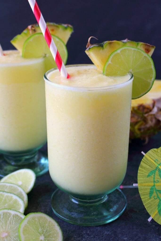 Meet your new favorite summer cocktail! This incredible Pineapple Daiquiri recipe is made with fresh pineapple, limes and coconut rum. Perfect for sipping poolside or blending for all of your friends at your next summer cookout!