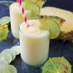 Meet your new favorite summer drink! This incredible Pineapple Daiquiri recipe is made with fresh pineapple, limes and coconut cream. Perfect for sipping poolside or blending for all of your friends at your next summer cookout!