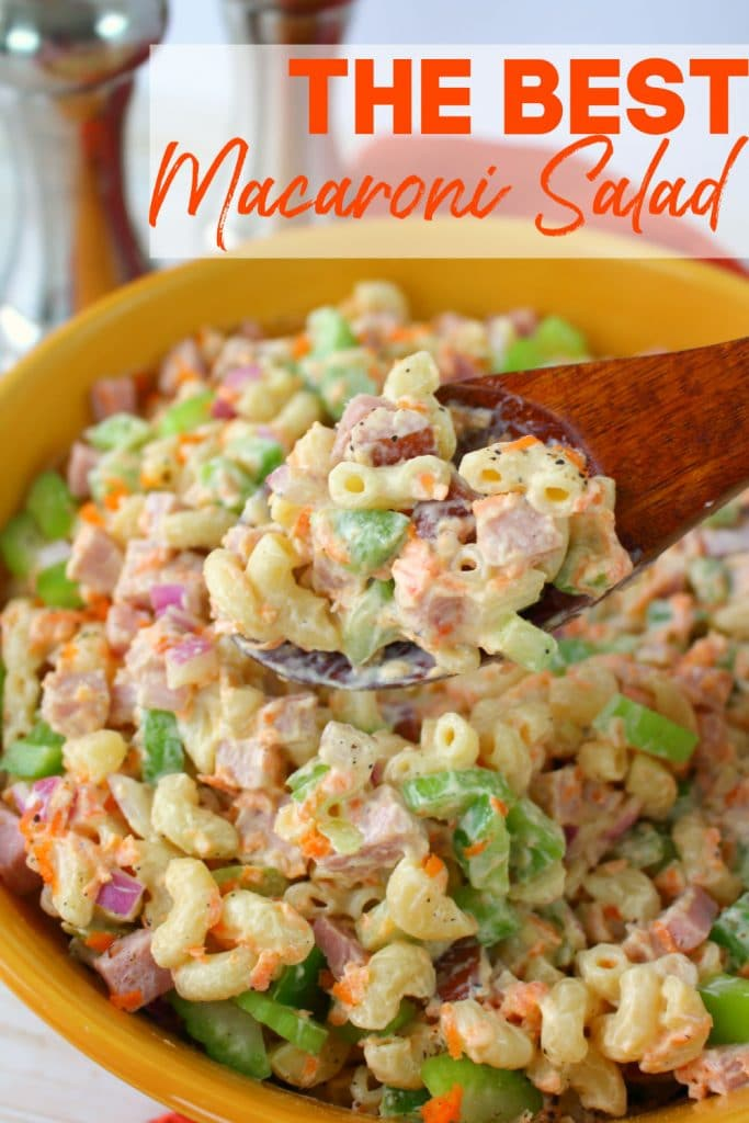 Classic macaroni salad in large bowl, with spoonful of salad in center of photo.