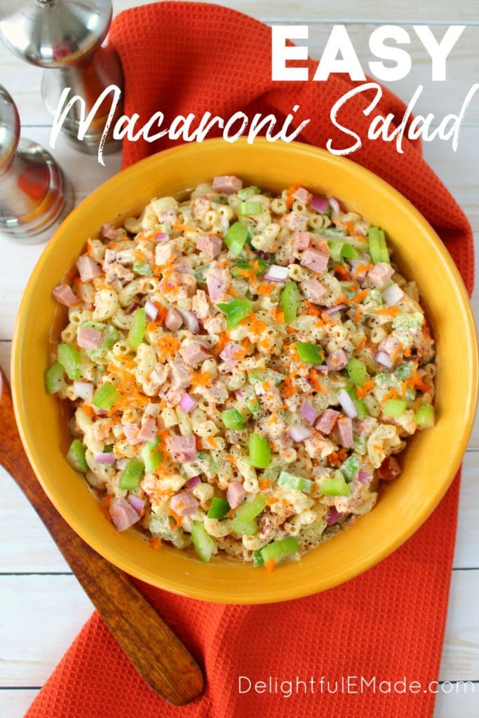 Large bowl of classic macaroni salad with celery, carrots and onion.