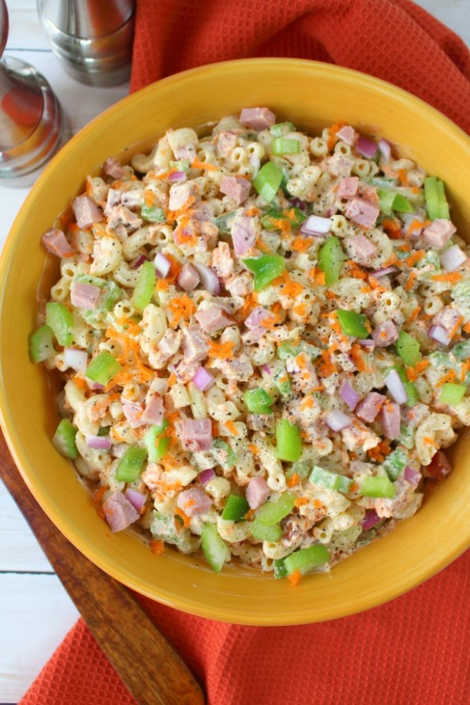 The ultimate Macaroni Salad recipe! Loaded with fresh carrots, celery, diced bell pepper, red onion, and savory ham, this Classic Macaroni Salad is perfect side dish for your next cookout or pot-luck.