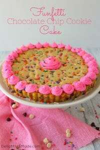 This Funfetti Giant Chocolate Chip Cookie Cake has party written all over it! Make with lots of rainbow sprinkles, white and semi-sweet chocolate chips and topped with a delicious buttercream frosting, this giant cookie is perfect for a birthday party or celebration!