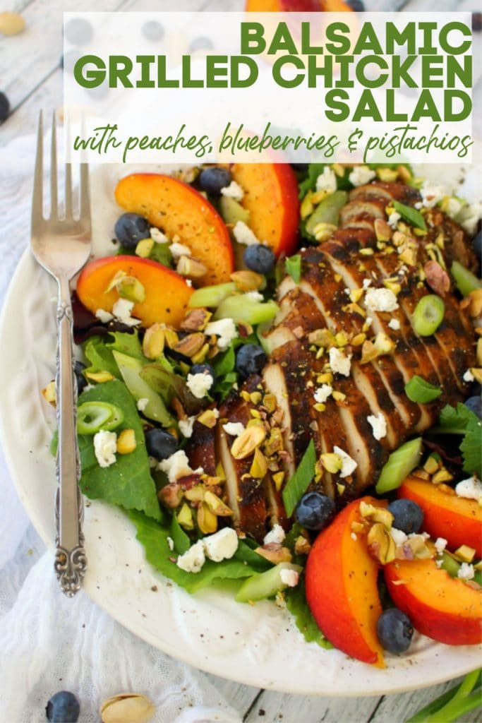 Salad greens topped with grilled sliced balsamic chicken breast atop of salad greens, sliced peaches, blueberries, pistachios and goat cheese crumbles.