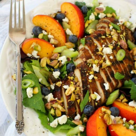 Craving a fresh, crisp entree salad? This savory, and slightly sweet Balsamic Grilled Chicken Salad will totally hit the spot! Made with fresh greens, fruit, pistachios and balsamic grilled chicken, this salad is healthy, filling and completely delicious!