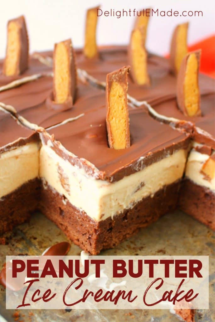 Peanut Butter ice cream cake cut into squares and topped with chocolate ganache and sliced peanut butter cups.