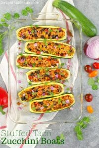 Looking for a healthy, low-carb dinner idea that actually tastes good? These Stuffed Taco Zucchini Boats are made with lean ground turkey filling along with peppers, onions, beans and corn. Loaded with flavor, these stuffed zucchini are the perfect healthy dinner!