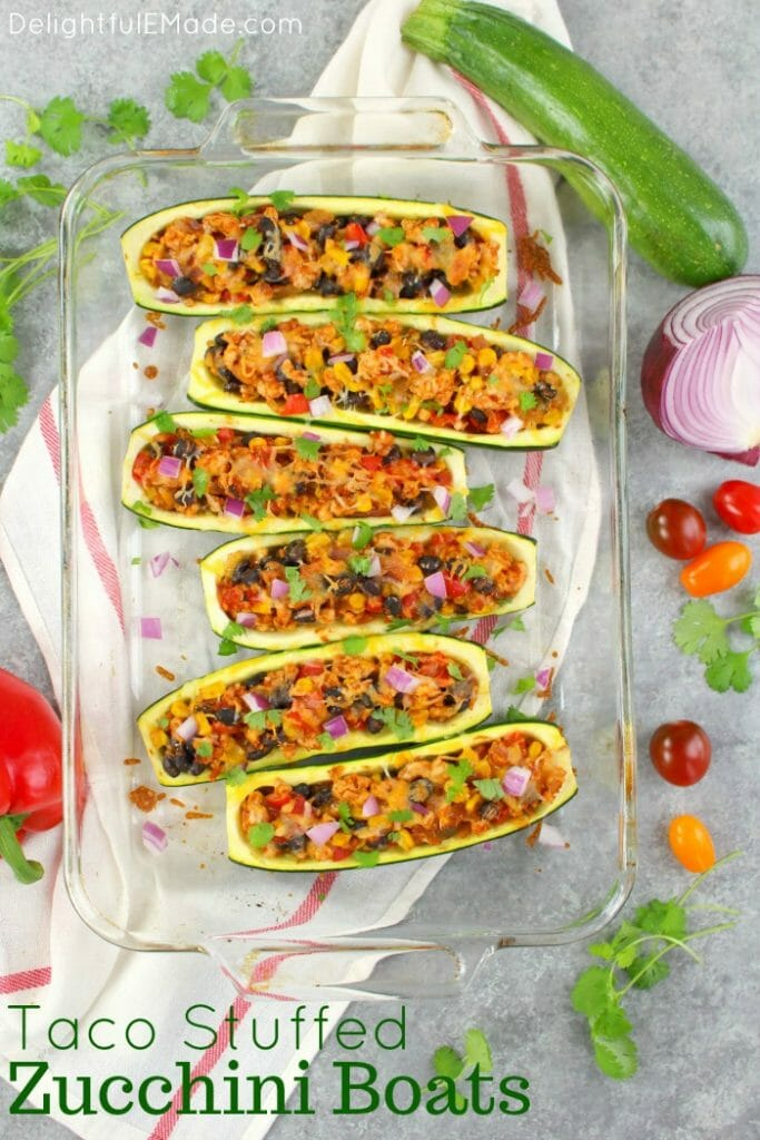 Looking for a healthy, low-carb dinner idea that actually tastes good? These Taco Stuffed Zucchini Boats are made with lean ground turkey filling along with peppers, onions, beans and corn. Loaded with flavor, these stuffed zucchini are the perfect healthy dinner!