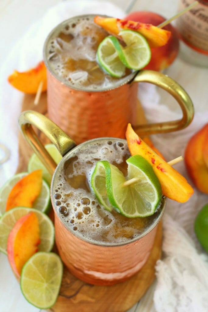 A delicious twist on the classic Moscow Mule recipe! Made with just a few simple ingredients, this Ginger Peach Moscow Mule combines the cold, crisp flavors of ginger beer with fresh peaches. Cheers!
