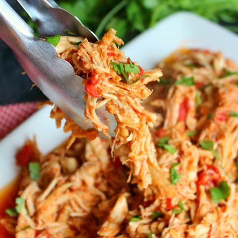 Say goodbye to dry shredded chicken! My super simple recipe Crock Pot Mexican Shredded Chicken will be your new go-to for the juiciest shredded chicken EVER! Perfect for tacos, enchiladas, nachos, burrito bowls and taco salads.