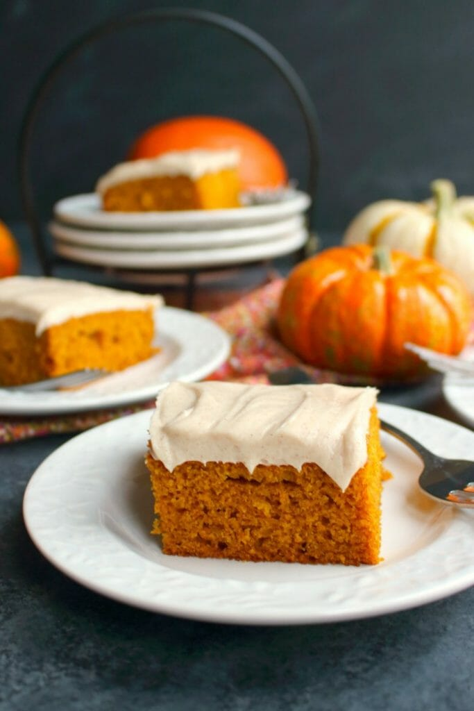 The perfect fall dessert! These Pumpkin Bars with Cinnamon Cream Cheese Frosting are like pumpkin sheet cake, but frosted with a thick, delicious layer of cream cheese frosting. Other dessert bars will be completely jealous of these showstoppers!