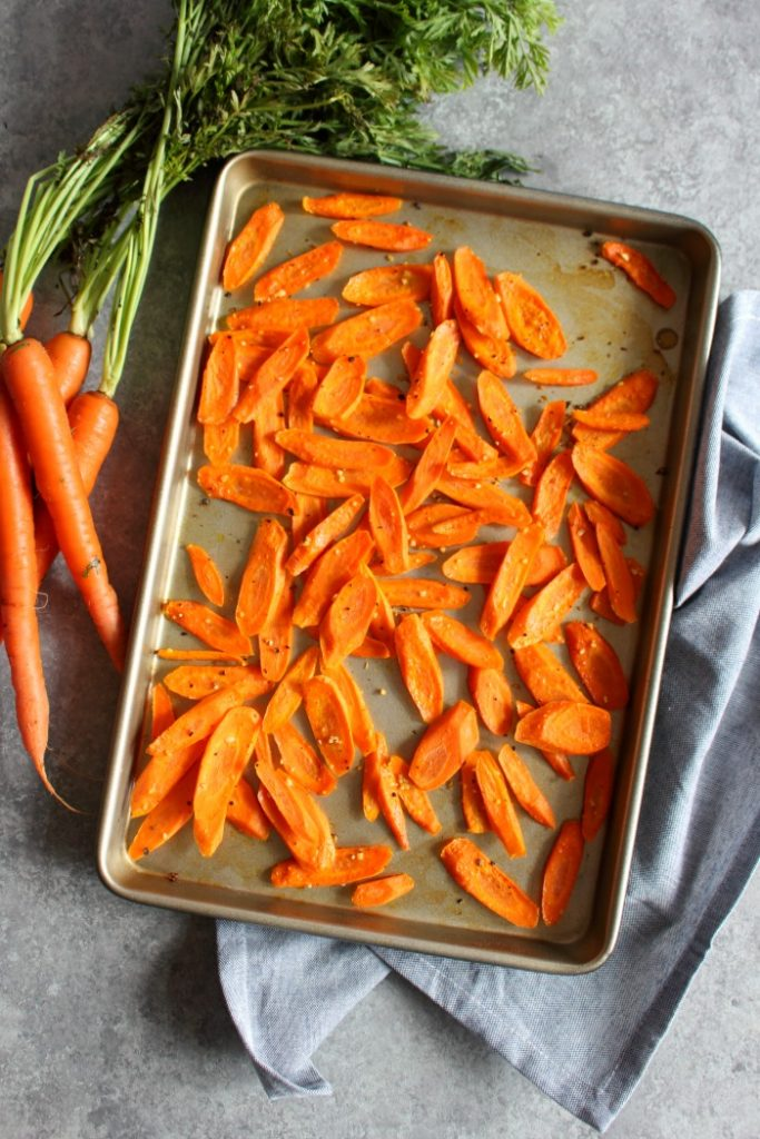 This Roasted Carrot Salad has wonderful flavors that come together with crisp apples and savory pistachios making the most amazing salad! Easy enough for a weeknight dinner, and beautiful enough to serve for a holiday dinner.