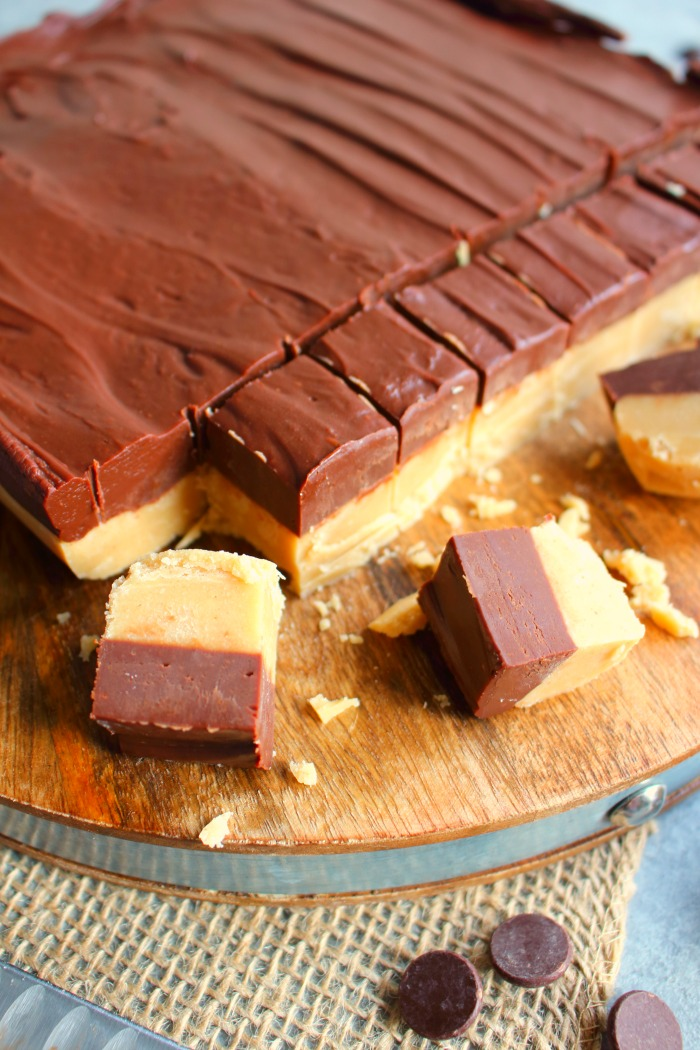 If you're looking for an amazing peanut butter fudge recipe look no further! This incredible Layered Chocolate & Peanut Butter Fudge is super simple to make and the perfect Christmas candy recipe!
