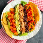 This simple Chicken Taco Salad recipe is the perfect healthy lunch for packing and taking to work! Loaded with savory shredded chicken, black beans and veggies, this taco salad will be your new favorite way to pack your lunch!