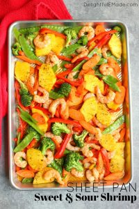 Love take-out food, but not all the calories and fat? This delicious, healthy Sheet Pan Sweet and Sour Shrimp recipe is fantastic for satisfying that craving! Crisp, delicious vegetables paired with tender shrimp in a light ginger sauce also makes for a healthy meal-prep idea!