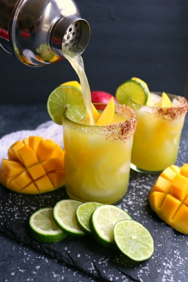 If you love a great margarita, then my Mango Margarita recipe is a must! Made with fresh mangoes, lime juice, tequila and Cointreau, this skinny margarita recipe is simple to make and completely delicious!