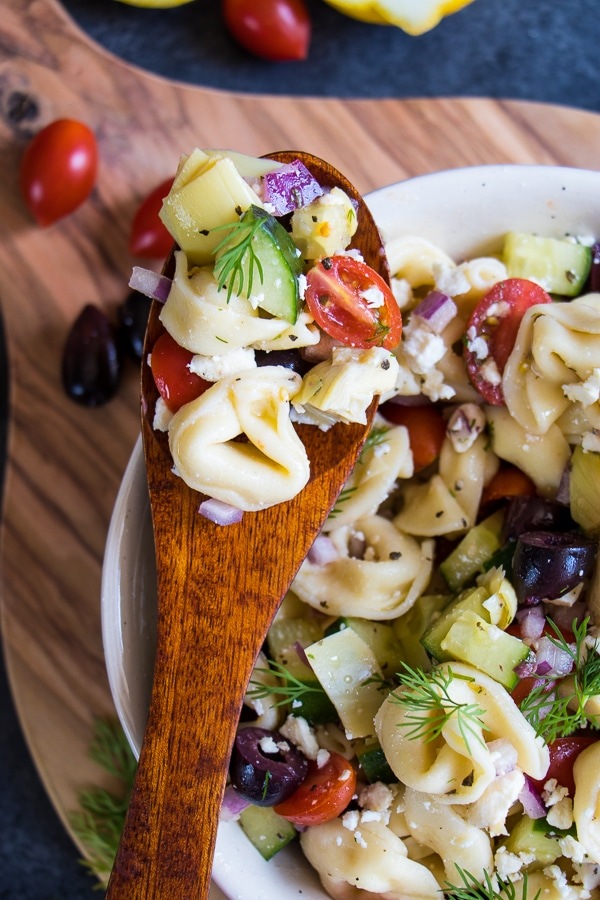 Do you love a really amazing, tortellini pasta salad? My Easy Greek Tortellini Salad recipe is the perfect dish for your next cookout. Loaded with all of your favorite Greek ingredients, this cold tortellini salad will be your new side dish for just about any meal!