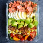 This Salmon Cobb Salad Recipe will be your new favorite way to enjoy lunch! Made with grilled salmon, avocados, hard-boiled eggs and more, this Grilled Salmon Salad is healthy, easy to make and incredibly delicious!