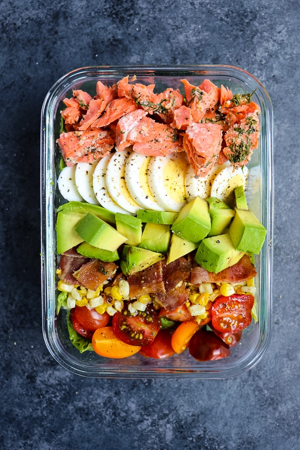 This Salmon Cobb Salad Recipe will be your new favorite way to enjoy a healthy lunch! Made with grilled salmon, avocados, hard-boiled eggs and more, this Grilled Salmon Salad is the perfect meal prep salad idea!