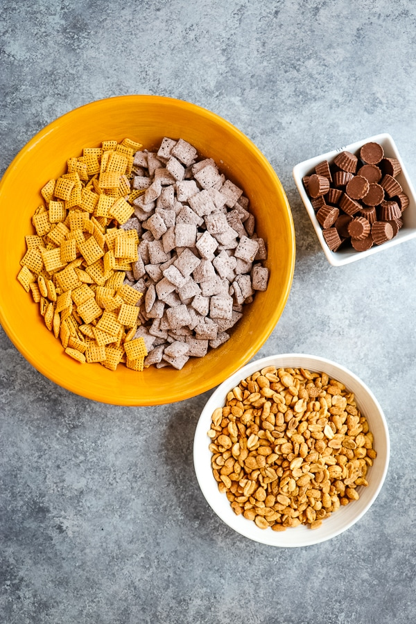 With summer in full swing, I've got the perfect sweet chex mix recipe to take along! This delicious Loaded Peanut Butter Chex Party Mix is made with chex mix muddy buddies and is the perfect treat to take to the pool, along for bike rides and at the basketball court.