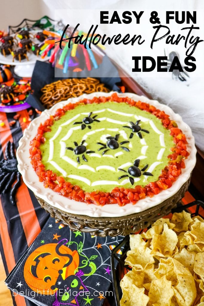 Halloween party buffet, with platter of bean dip with olive spiders as garnish.