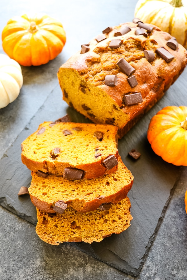 loaf of healthy pumpkin bread, sliced with chocolate chunks.