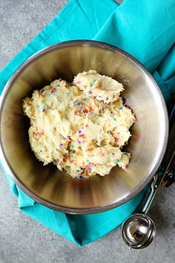 If you love an easy cookie recipe, these Funfetti Cake Mix Cookies are for you! Made with just a few simple ingredients, these cream cheese cake mix cookies are fantastic with rainbow sprinkles or Christmas sprinkles. Fantastic for just about any celebration!