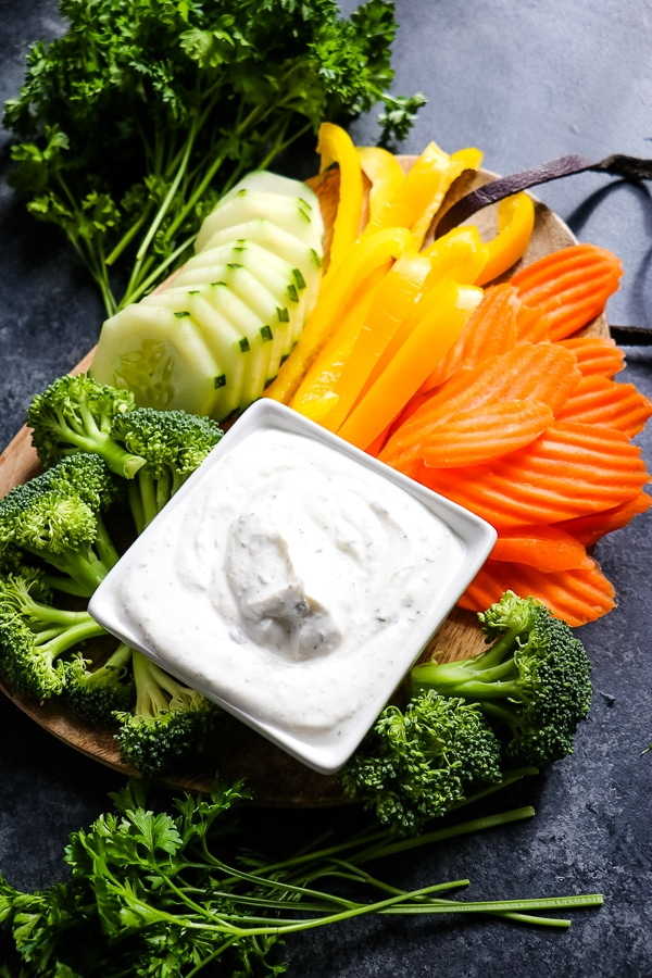 Need a healthy snack option? This simple, 5-ingredient Greek Yogurt Veggie Dip is the perfect way to enjoy fresh veggies. Enjoy with veggies, spread on a sandwich or topping a salad, this Greek Yogurt Ranch Dip is a great alternative to a dip mix!