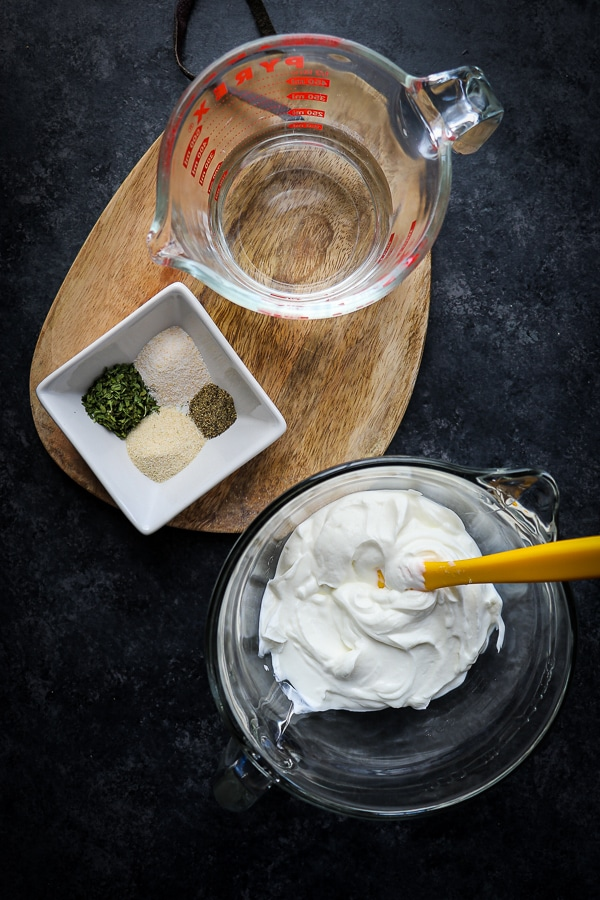 Looking for a healthy homemade ranch dressing? Look no further - this Greek Yogurt Ranch Dressing tastes just like the real deal! Made with just 6 ingredients and NO oils or sugar, this healthy ranch dressing recipe will be your new go-to for ranch!