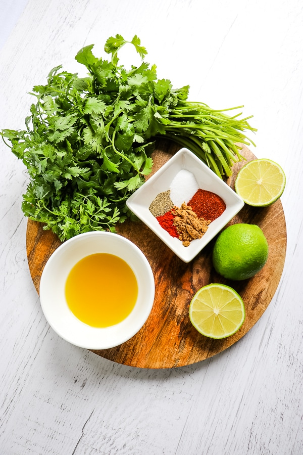 Cilantro, olive oil, limes, and spices for cilantro lime chicken marinade.