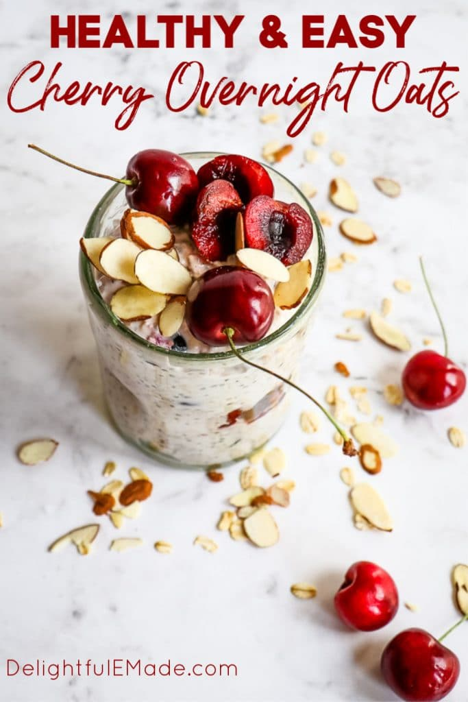 Jar of cherry overnight oats, topped with fresh cherry halves and sliced almonds.