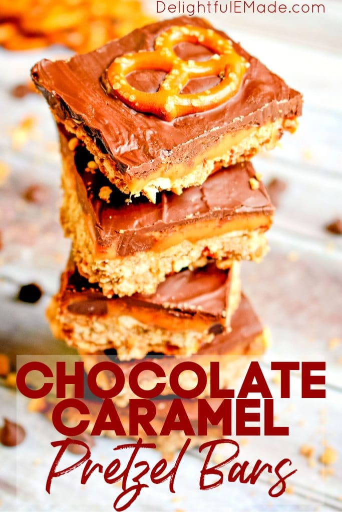 A stack of chocolate caramel pretzel bars garnished with chocolate chips and pretzel twists.