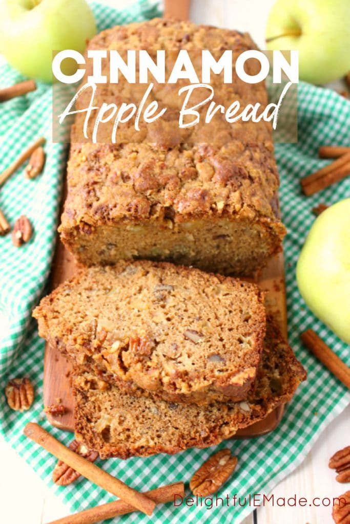 Cinnamon Apple Bread, loaf sliced and garnished with cinnamon sticks and pecans.