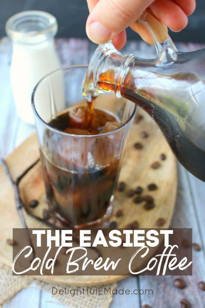 Pouring cold brew coffee over ice in a tall glass.