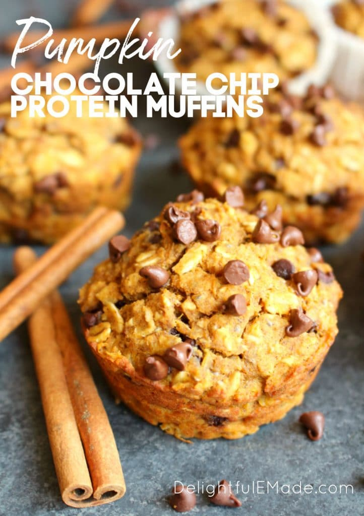 Pumpkin Chocolate Chip Protein Muffins garnished with cinnamon sticks and mini chocolate chips.