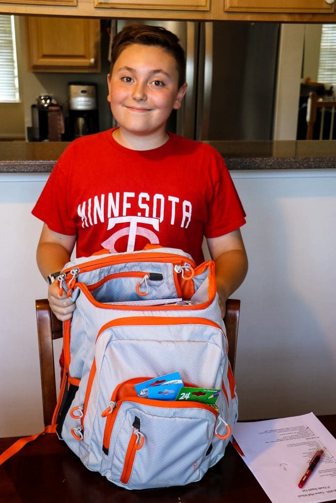 Harrison with his backpack packed for school.