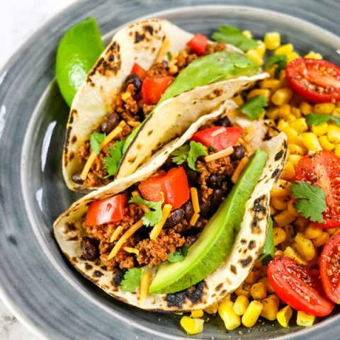 Easy taco recipes, how to make tacos from scratch, soft tacos on plate with corn salsa.