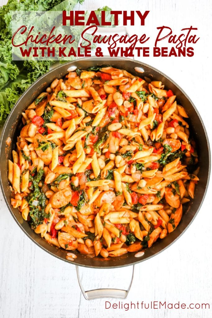 Large skillet with chicken sausage pasta with kale, white beans, tomatoes and roasted red peppers.