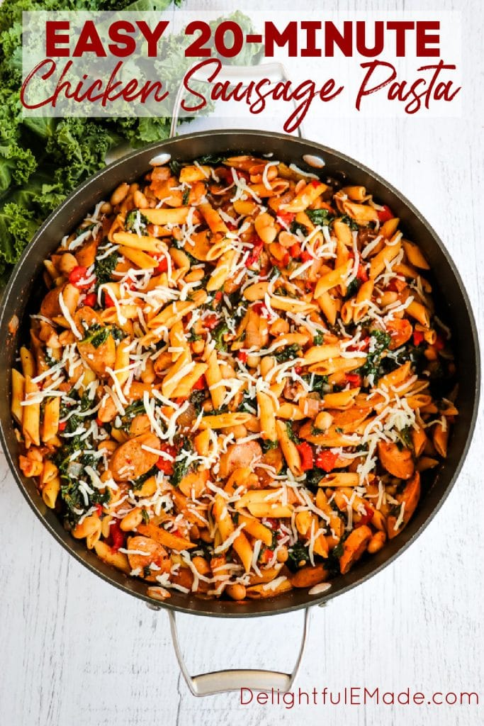 Large skillet with chicken sausage pasta with kale, white beans and roasted red peppers.