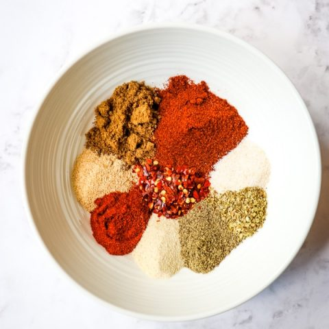 Homemade taco seasoning - spices in a white bowl.