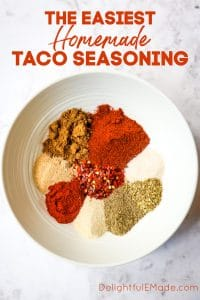 Homemade taco seasoning - multiple spices in a white bowl.